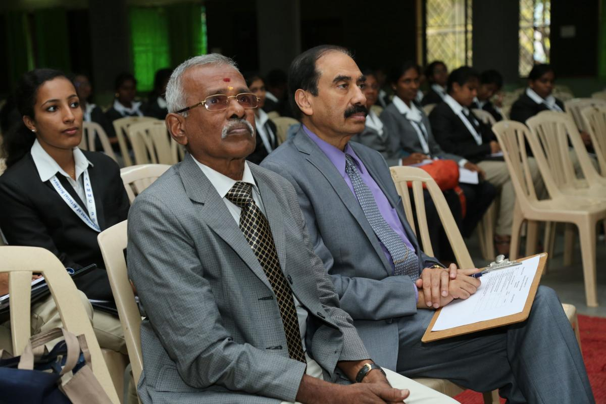 Dinesh sitting at conference
