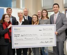 Dean Heather Norris, second from left, receives a $70,000 check from Independent Insurance Agents of North Carolina CEO Aubie Knight, second from right.