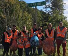 Student members of AppState Executive Impact Club (and a couple family members) during a Fall 2017 street clean-up.