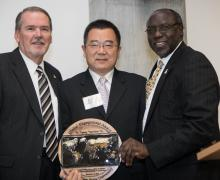 """Dr. Randy Edwards, Appalachian's vice chancellor for university advancement, far left, and Dr. Jesse Lutabingwa, associate vice chancellor for international education and development at Appalachian, far right, present Jigang """"Harrison"""" He with the inaugural Appalachian Global Engagement Award at the Global Leadership Awards Luncheon held during Appalachian's International Education Week in November."""