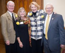 Standing left to right, John and Faye Cooper, Appalachian State University Chancellor Sheri N. Everts and Mayor Roy James Maness. The Coopers and Maness were recently named honorary alumni by the university's alumni association. Photo by Marie Freeman