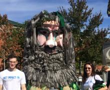 AppState Net Impact members Cullen Lee, left, and Meredith Lemon with Green Yosef.