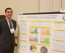 Preston MacDonald with his research poster at the 2018 State of North Carolina Undergraduate Research and Creativity Symposium