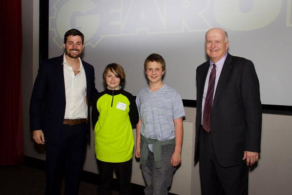 "Riley Underwood, second from left, and Kyle Hollars, third from left — both students at Mabel School in Watauga County who compose team Sunlight Foods — pose with Jonathan Carpenter, assistant director of the WCOB's Transportation Insight Center for Entrepreneurship, far left, and Robert E. ""Bob"" Washburn, president and CEO of LifeStore. Underwood and Hollars won an honorable mention in the middle school category of Appalachian's GEAR UP Pitch Competition for their idea of developing a food market in Zionvi"