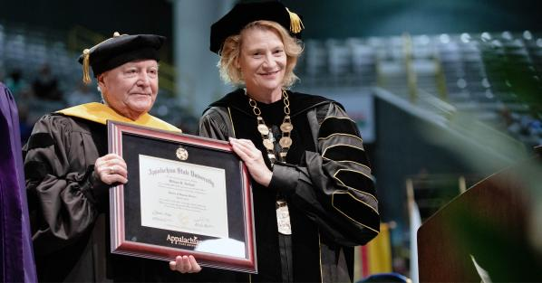 """Appalachian Chancellor Sheri Everts, right, presents Dr. William """"Bill"""" Holland with an honorary Doctor of Humane Letters. Photo by Chase Reynolds"""
