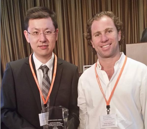 Appalachian State University Associate Professor of Economics Ji Yan, left, with Eastern Economic Journal Associate Editor Diego Nocetti