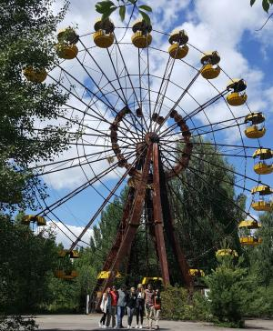 Appalachian State University students Sarah Willis, Trace Edmunds, Nikolas Kapetanich-Pittser, Jordan Silcox, Sloan Evans, Alex Angeli, and Walker College Associate Dean Sandra Vannoy stand in front of the iconic Ferris wheel at the site of the long-abandoned Pripyat amusement park near Chernobyl.