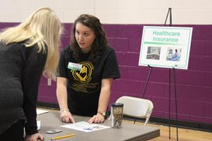 RMI major Abby Young offers financial advice to an Ashe County High School student during a financial literacy workshop offered by the Walker College of Business in partnership with SECU and Appalachian GearUp.