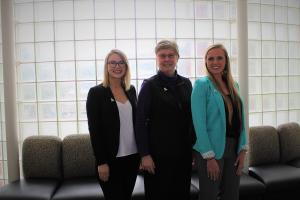 From left, Keirsten Henson, Dawn Medlin and Victoria Fowler prepare for the annual security conference