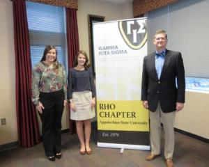 From left, students Peyton McAvoy, Shelby Weatherman with NCAMIC President Mike Williams at Appalachian State University