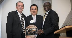"Dr. Randy Edwards, Appalachian's vice chancellor for university advancement, far left, and Dr. Jesse Lutabingwa, associate vice chancellor for international education and development at Appalachian, far right, present Jigang ""Harrison"" He with the inaugural Appalachian Global Engagement Award at the Global Leadership Awards Luncheon held during Appalachian's International Education Week in November."