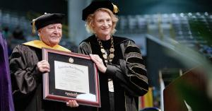 "Appalachian Chancellor Sheri Everts, right, presents Dr. William ""Bill"" Holland with an honorary Doctor of Humane Letters. Photo by Chase Reynolds"