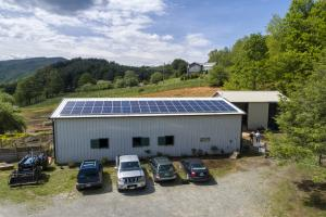 Rows of solar panels line the south-facing side of the Horse Helpers of the High Country barn in Zionville. The panels power the barn as well as the organization's approximately 2 acres of electric fencing.