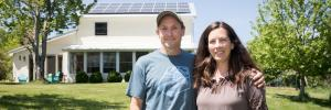 The Westermans in front of their home, which holds 50 solar panels and generates enough power for their family of four, with extra to share. The Westermans in front of their home, which holds 50 solar panels and generates enough power for their family of four, with extra to share.