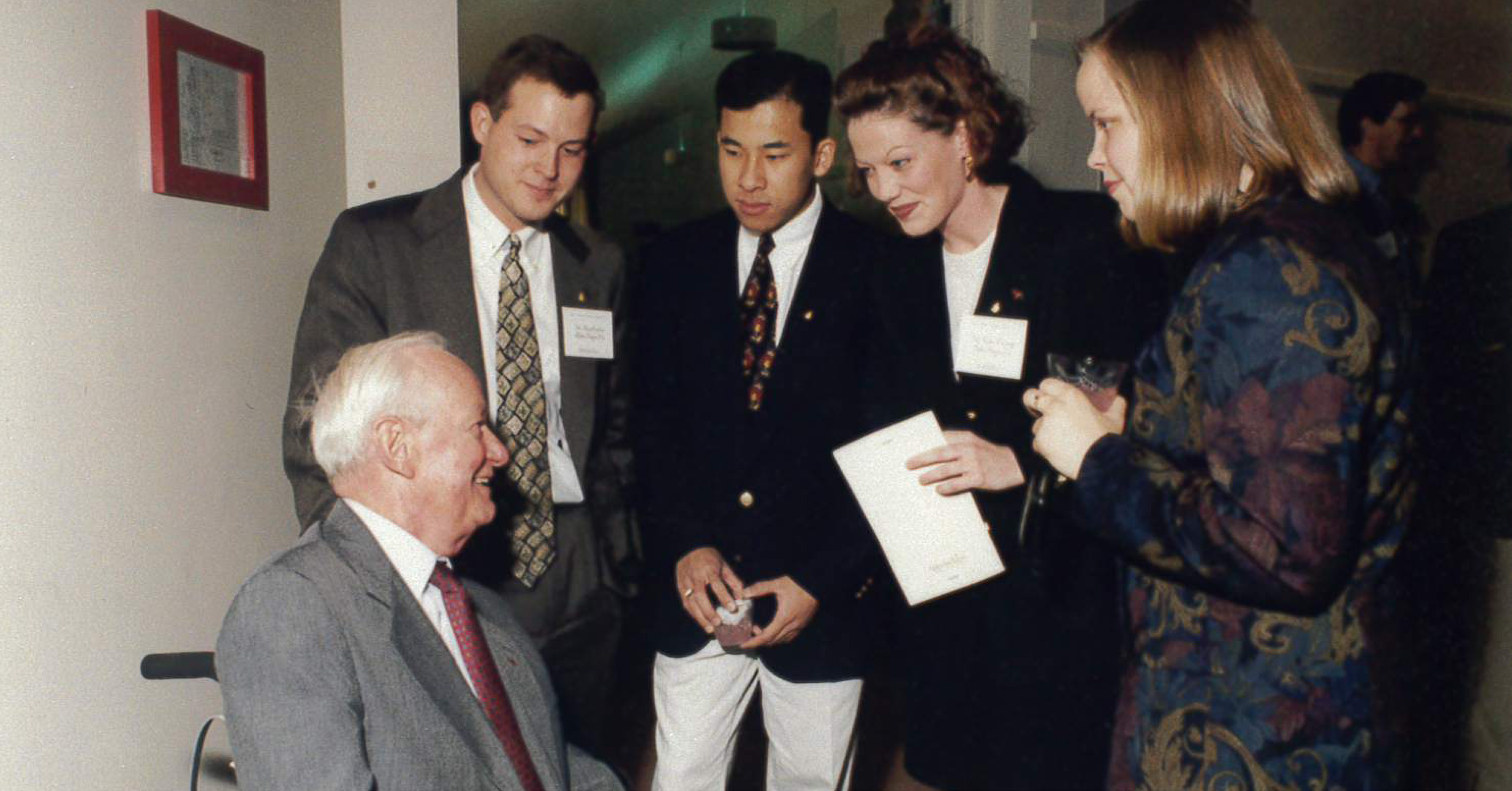 Harlan Boyles, seated, with attendees of a 1996 Boyles Lecture