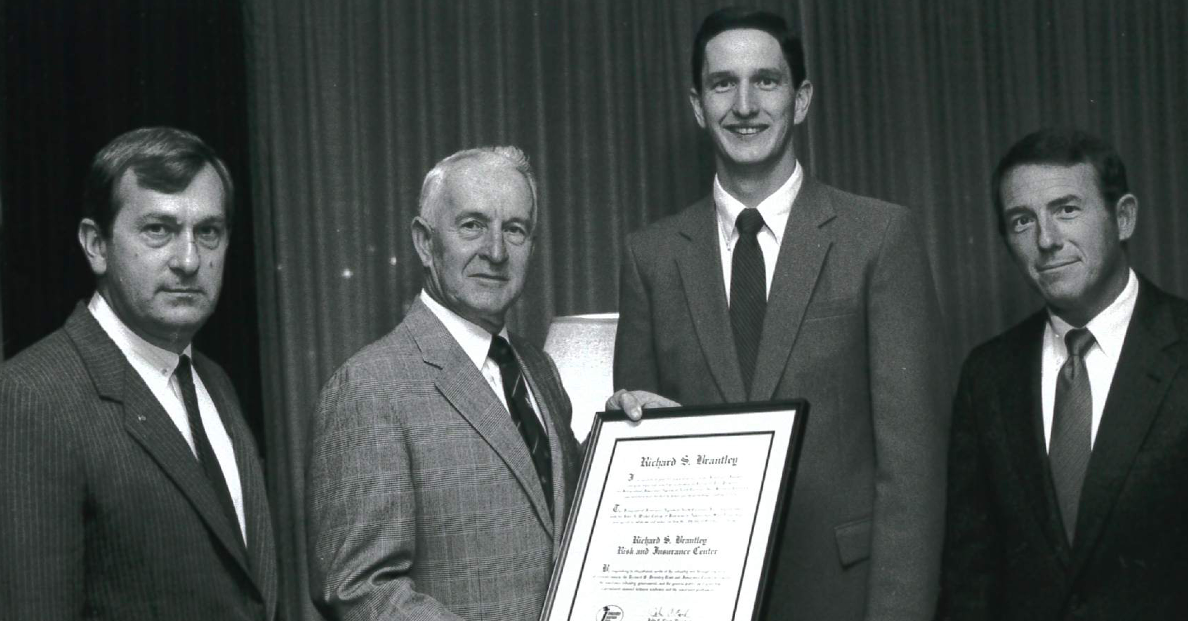 Paul Combs (left), Walker College Dean; Richard Brantley, retired IIANC Executive Vice President (holding plaque); Dave Wood, Brantley Center Director; and (far right) Harry Davis, Chairperson of Finance, Insurance and Real Estate
