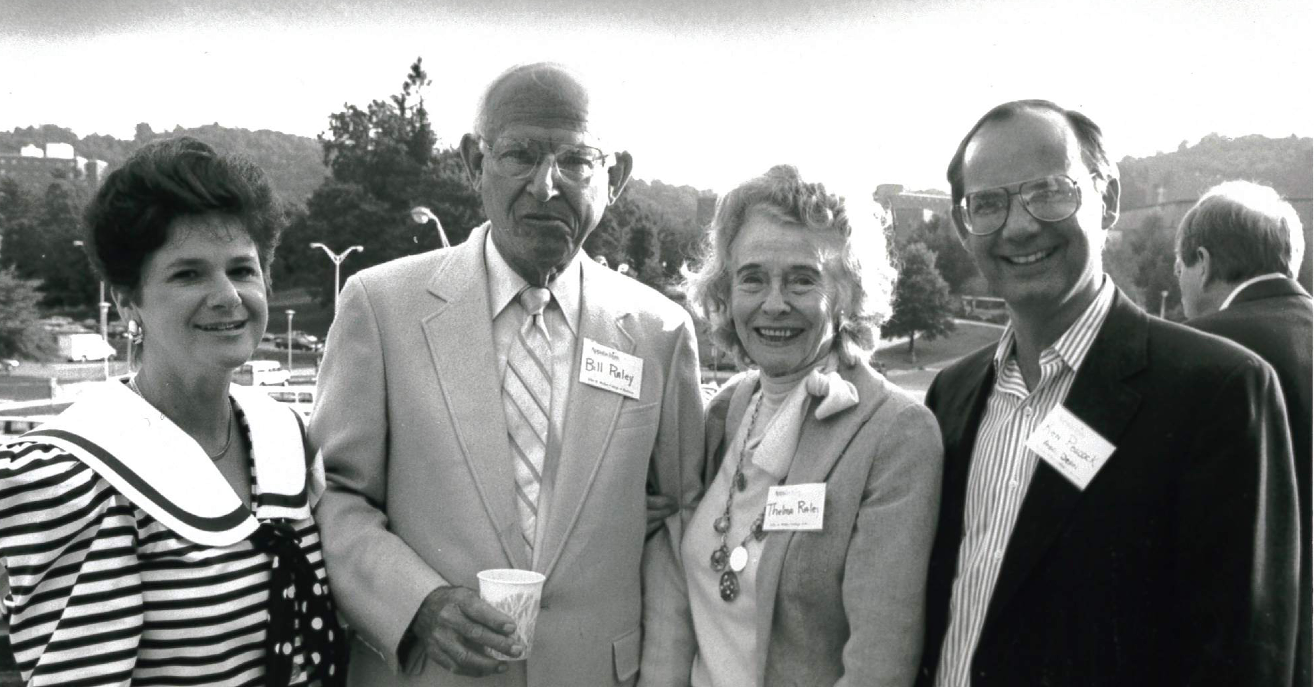 Bill and Thelma Raley (center), friends of the Walker College, stand between Associate Dean Ken Peacock and his wife, Rosanne.