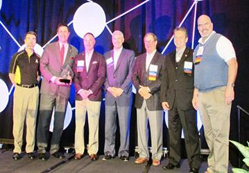 Brantley Risk & Insurance Center Associate Director Greg Langdon, left, presented IIANC CEO Aubie Knight, second from left, and members of the IIANC Board of Directors Scott Evans, Jeff Haney, Bill Vogedes, Jim Mozingo and past Chairman Bobby Salmon