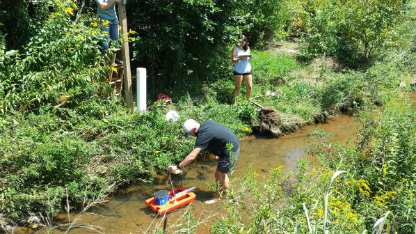 Eric Cheek '18, Quantitative Geoscience major and Carly Maas, senior, Quantitative Geoscience major, measuring stream discharge in Boone Creek. Photo by Dr. William Anderson.