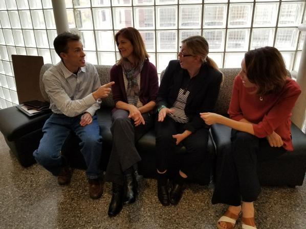 Economics Researcher David Dickinson, left, shares a moment with Accounting Researcher Tammy Kowalczyk, Marketing Researcher Pia Albinsson and Management Researcher Carol Kline