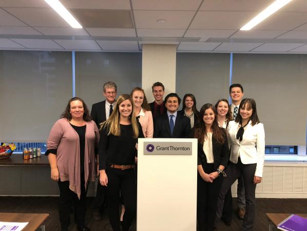 Pictured from left are Fuentes, Business Professor Lewis Alexander and Grant Thornton Associate Alex McLanahan with students Ivy Wagner, Mason Garwood, Cole Maita, Sarah Fishel, Alex Selby, Paige Schurter, Sara Velasco and Logan Turner at Grant Thorton Manhattan.