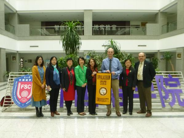 Pictured are Wendy Deng, Sandra Vannoy, Christopher Lytle and Martin Meznar with their counterparts at Northeastern University in Shenyang