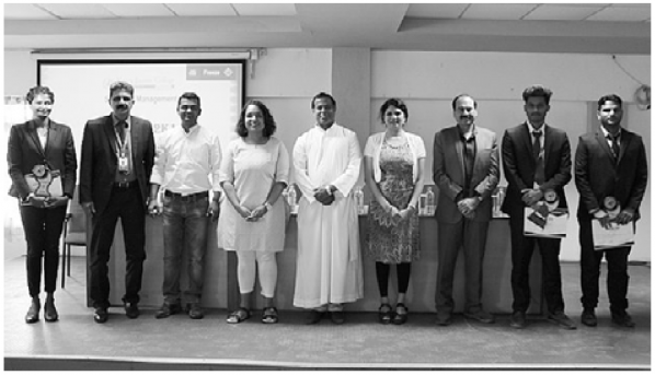 The pictured Walker College of Business faculty members are Dr. Jamie Parson, Assistant Professor of Finance (pictured fourth from left), Dr. Lakshmi Iyer, Professor of Information Systems and Director of the Applied Data Analytics program (fourth from right) and Dr. Dinesh Dave, professor  and director of supply chain management (third from right).