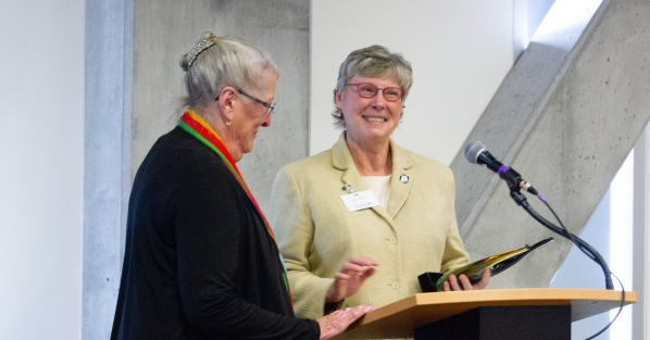 Dawn Medlin presents a gift to Doris Medlin, to recognize the establishment of the Bob and Doris Medlin Scholarship, named for Medlin.