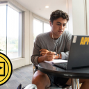 Zach Covington, a first-year exercise science major at Appalachian, looks at his laptop while taking notes. Photo by Chase Reynolds