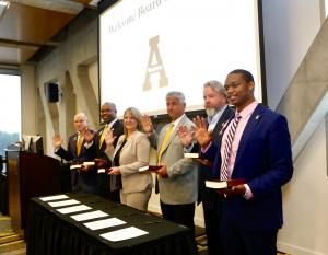 "The six individuals who were sworn in as members of the Appalachian State University Board of Trustees during the board's Sept. 13 meeting held on Appalachian's campus. They are, from left to right, John M. Blackburn, James ""J.K."" Reaves '93, Kimberly Shepherd '97, Thomas Sofield '76, Mark E. Ricks '89 and DeJon Milbourne. Administering the oath of office was North Carolina District Court Judge Rebecca Eggers-Gryder '83 (not pictured)."