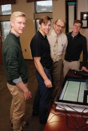Photo of Kiefer Smith, left, Dan Emery, Associate Dean Martin Meznar and Cameron Barnett.