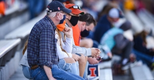 Fans wearing masks during a college football game between the Minnesota Golden Gophers and Illinois Fighting Illini on November 7, 2020 at Memorial Stadium in Champaign, ILL