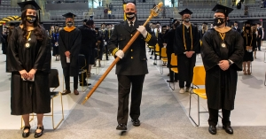 Johnny Brown, captain of operations for Appalachian State University's Appalachian Police Department, carries the university mace during one of App State's 13 in-person Spring 2021 Commencement ceremonies, held May 7–12 in Holmes Convocation Center on App State's campus.