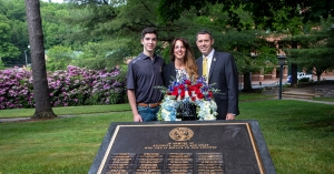 Air Force veterans David H. Cook, far right, and Christy M. Cook '18, center, are joined by their son, Wyatt Cook, as they place a wreath at Appalachian State University's Veterans Memorial to commemorate Memorial Day 2021. The couple was selected for the honor by App State Chancellor Sheri Everts. David is the director of constituency relations and scheduling in the Office of the Chancellor and Christy is a lecturer in the university's Department of Marketing and Supply Chain Management.