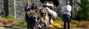 Alexandra LaRocca, a senior communication studies major from Raleigh, was crowned Appalachian State University's 2020 Top of the Rock by university mascot Yosef as App State Chancellor Sheri Everts, far left in background, looked on. The ceremony was prerecorded in Founders Plaza during Homecoming Week and then screened during the homecoming football game Oct. 22.