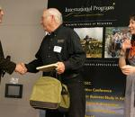 Dr. Al Harris, center, receives the Lifetime Achievement Award from Dr. Marty Meznar, left.