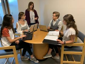 Dr. Tammy Kowalczyk, professor of accounting and interim director of Appalachian's RIEEE, third from left, and Appalachian alumnus Alex Helms '13 '16, a lecturer in the Department of Accounting, second from right, work with three Appalachian international exchange students on an Impact Clinic project. The students pictured — all of whom are from Spain with double majors in business and law — are, from left to right, Soledad Jarquemada, Maria Leon Martinex Maria Leon Martinex and Angela Munoz Perez-Embid.