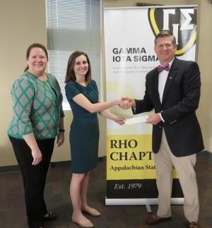 Appalachian junior Avery Fink, center, with NCAMIC President-Elect Jennifer Lineberry, left, and NCAMIC President Mike Williams