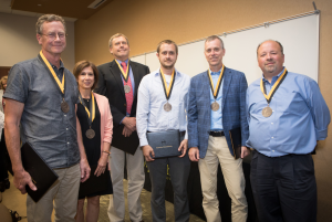 """Winners of the 2018 Appalachian Excellence in Teaching Awards at the Fall Semester Faculty and Staff Meeting. From left: Dr. Thomas Whyte, professor in the Department of Anthropology; Dr. Susan Staub, professor in the Department of English; Dr. Richard Pouder, professor in the Department of Management; Dr. Gabriele Casale, associate professor in the Department of Geological and Environmental Sciences; Dr. William """"Bill"""" Anderson, professor in and chair of the Department of Geological and Environment Science"""