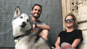 Chase Warrington '08 and his wife, Allison, and their 50-pound husky Koda in Valencia, Spain, where they live and work remotely